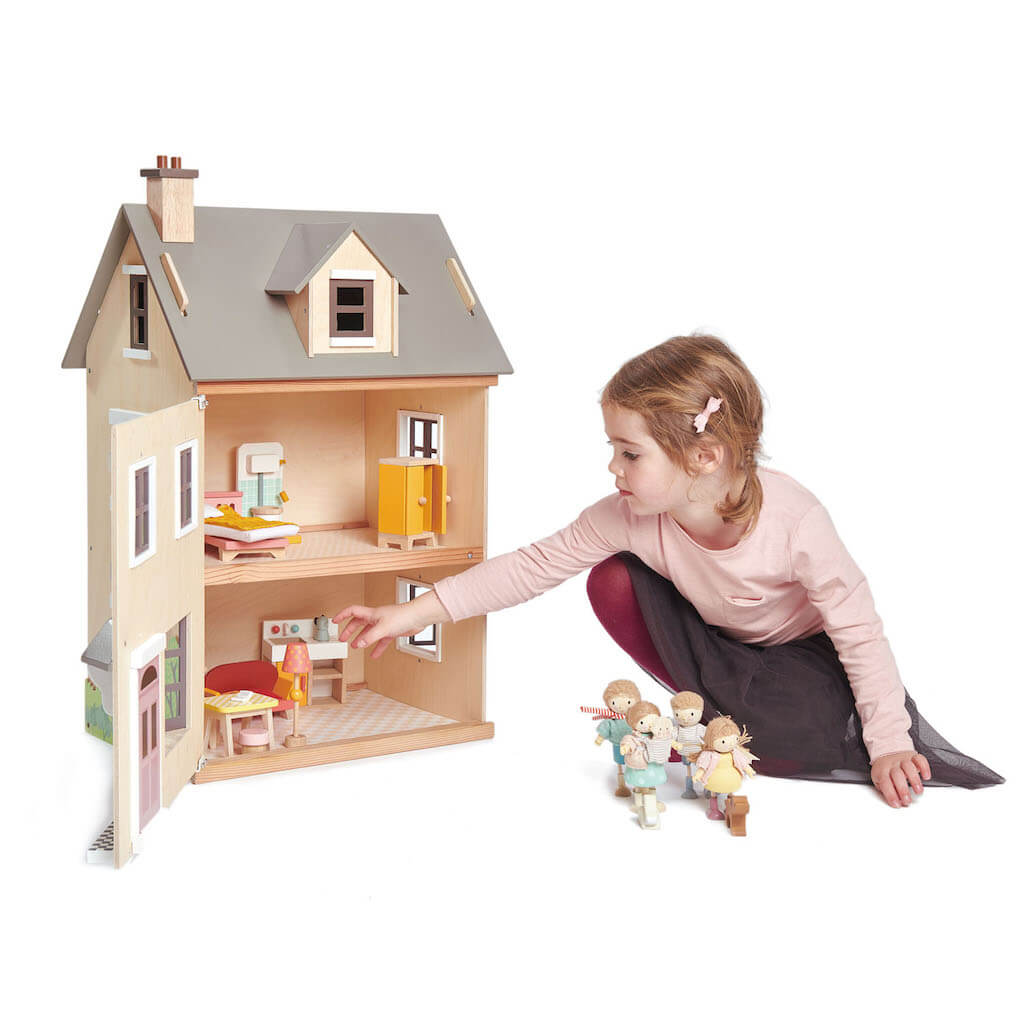 Girl playing with the Tender Leaf Toys Foxtail Villa Dolls House