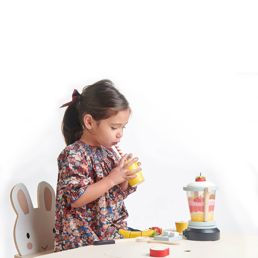 Girl pretending to drink whilst playing with Tender Leaf Toys Fruity Blender
