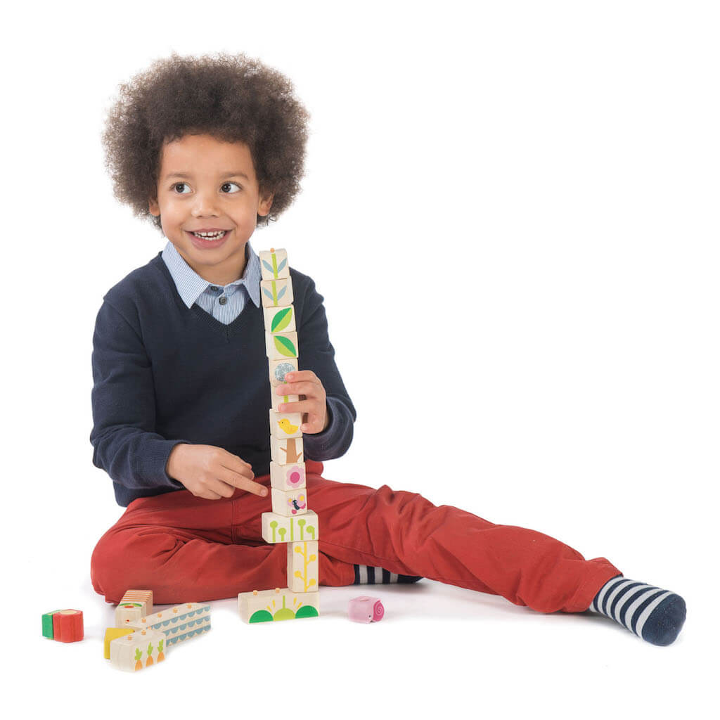 Boy playing the the Tender Leaf Toys Garden Blocks