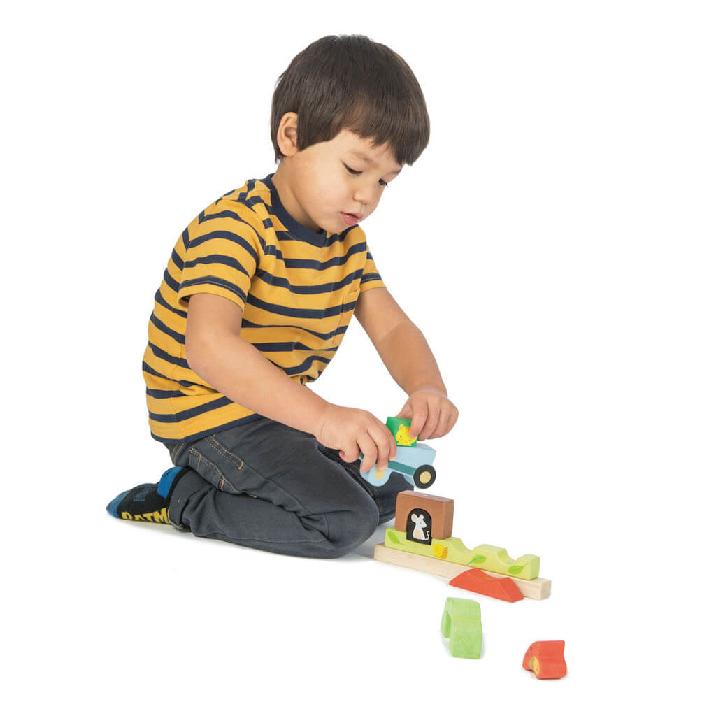 Boy playing with the Tender Leaf Toys Garden Magnetic Puzzle