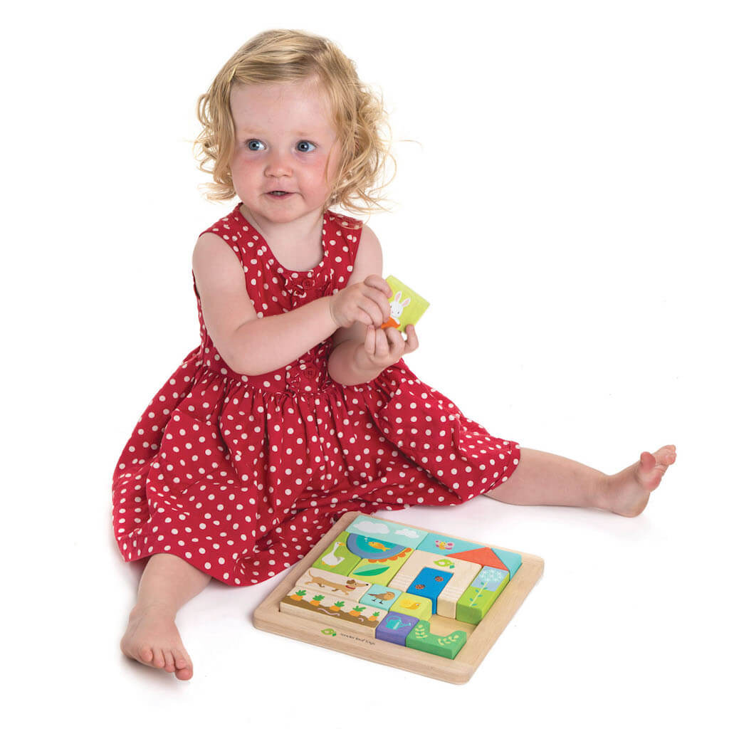 Girl playing with the Tender Leaf Toys Garden Patch Puzzle