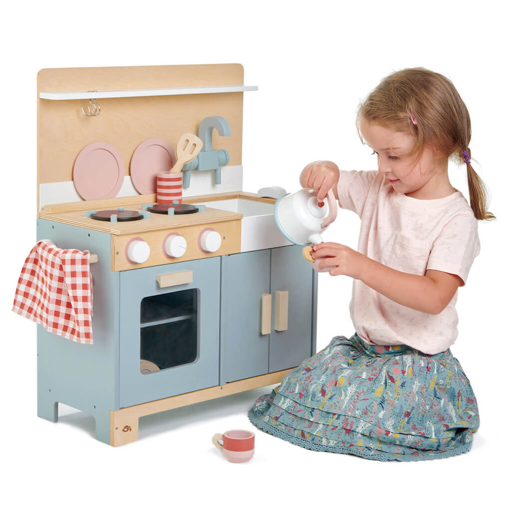 Girl playing with the Tender Leaf Toys Home Kitchen