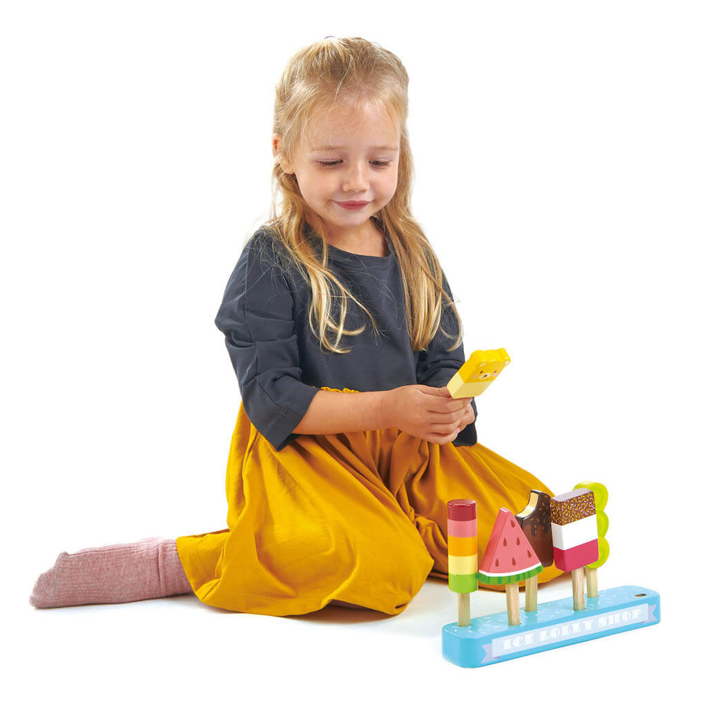 Girl playing with Tender Leaf Toys Ice Lolly Shop