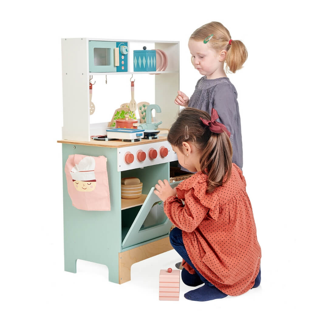 Two girls playing with the Tender Leaf Toys Kitchen Range