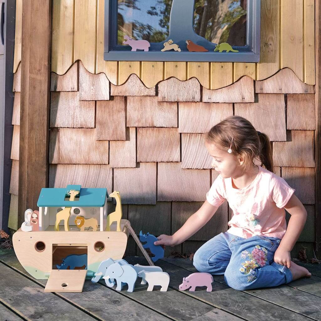 Girl playing with the Tender Leaf Toys Noah's Wooden Ark