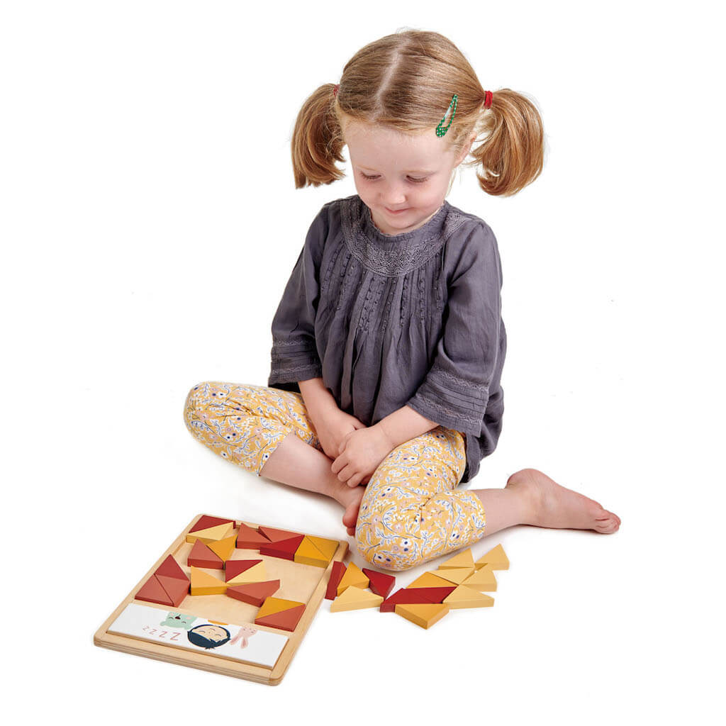 Girl playing with the Tender Leaf Toys Patchwork Quilt Puzzle