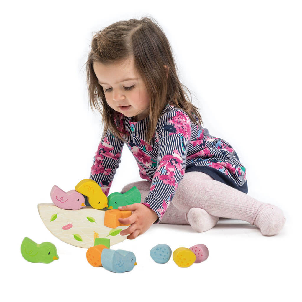 Girl playing with the Tender Leaf Toys Rocking Baby Birds