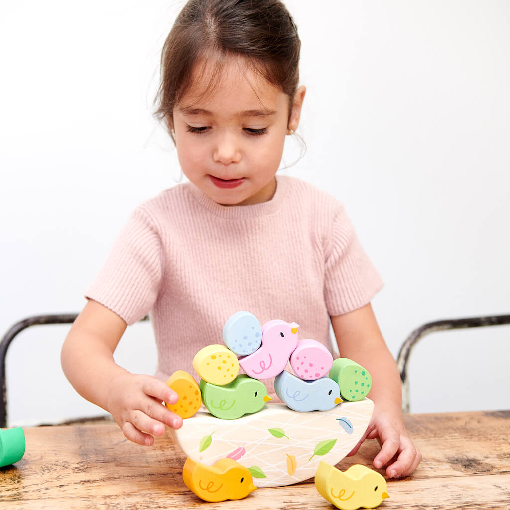 Girl Stacking the Tender Leaf Toys Rocking Baby Birds