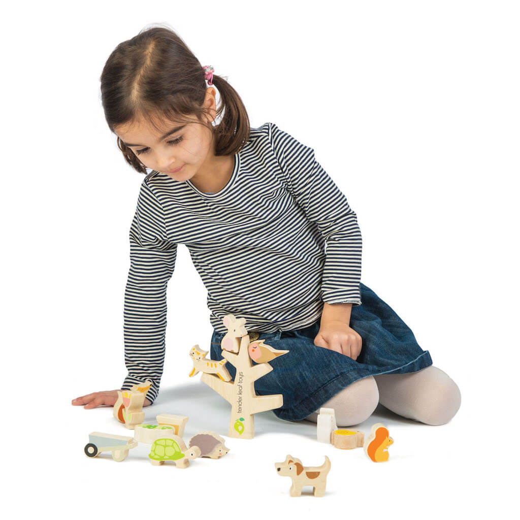 Girl playing with Tender Leaf Toys Stacking Garden Friends