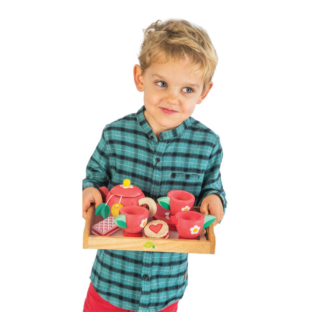 Boy playing with Tender Leaf Toys Tea Tray Set
