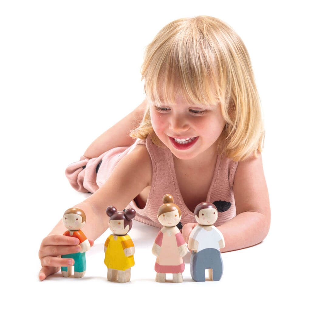 Girl playing with Tender Leaf Toys The Leaf Family Doll Set