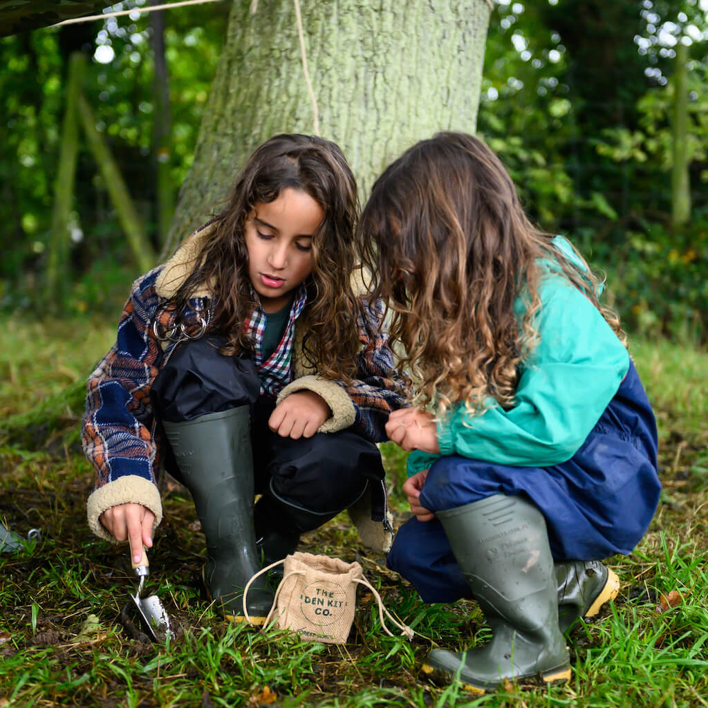 Two girls playing with The Den Kit Co The British Woodland Den Kit