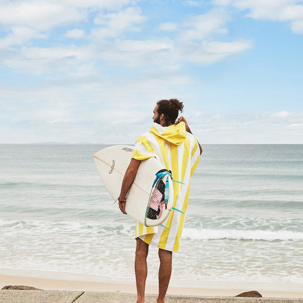 byron bay surfing with striped hooded poncho towel