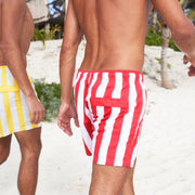swim shorts come in yellow and red designs