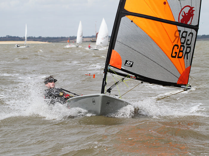 Reaching, ahead of Lasers on the first day of racing.
