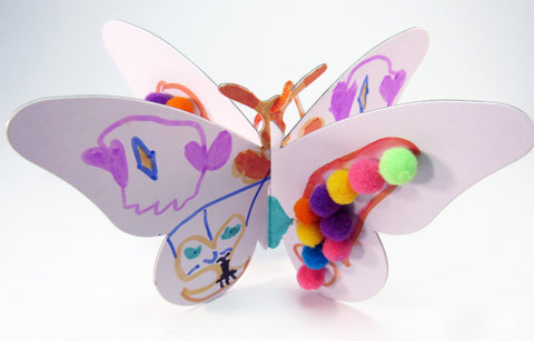 3-dimensional butterfly art project - Ivy Kids Educational Activity Kit featuring the book Gotta Go! Gotta Go! by Sam Swope and over 10 art, literacy, math, and science activities inspired by the story. Learn about monarch butterflies. Perfect kit for spring.