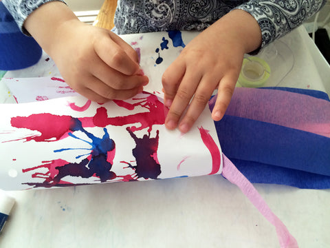 Make your own wind sock to go along with May's Ivy Kids kit featuring the book The Wind Blew by Pat Hutchins.