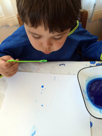Bubble Painting, creative art activity using wind energy, to go along with May's Ivy Kids kit featuring the book The Wind Blew by Pat Hutchins.