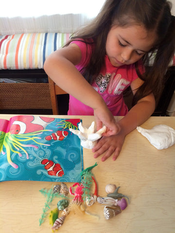 Science and art activity inspired by the book Over in an Ocean in a Coral Reef. Use clay, sea creatures and seashells to create your own coral reef.