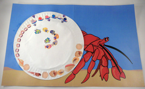 A decorated shell. A House for Hermit Crab - Ivy Kids subscription box activities.