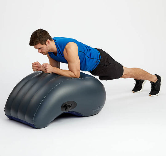 Man performing a plank and working his abs on an AeroTrainer