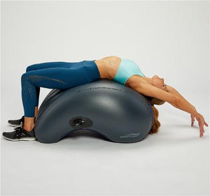 Woman using the AeroTrainer for an Upper Back Stretch.