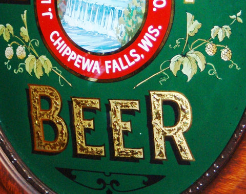 Closeup of Glue Chipping and Gold Leafed Elements in Leinenkugel Brewing Co ROG Sign