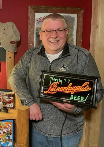 Satisfied Client Holding Leinenkugels Thirsty ROG Sign