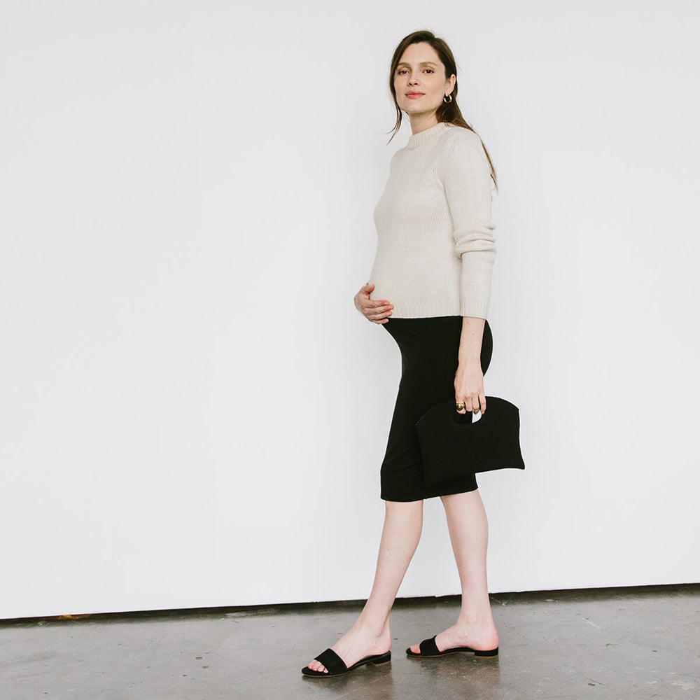 <p><b>What –</b> A sleek and sexy skirt that will convert everyone to bodycon (at least for pregnancy).</p> <p><b>When –</b> During pregnancy you can wear it pulled up over you belly and down at your hips postpartum. It's particularly clutch in the 3rd trimester.</p> <p><b>Where –</b> The double fabric design makes this particularly workplace-friendly, but it's also great with a crop top when you've got errands to run.</p> <p><b>Why –</b> This skirt makes everything into an instantly cute outfit with basically no effort.</p>