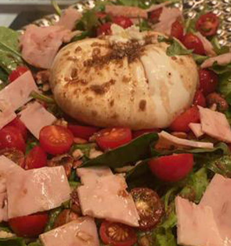 Salad made with Burrata and Tomatoes