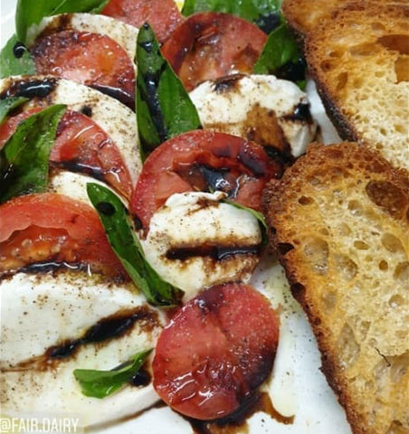 Caprese salad made with Fair Dairy cherry mozzarella cheese online in Delhi NCR