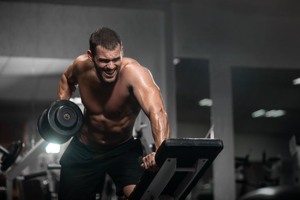 man working with dumbbels