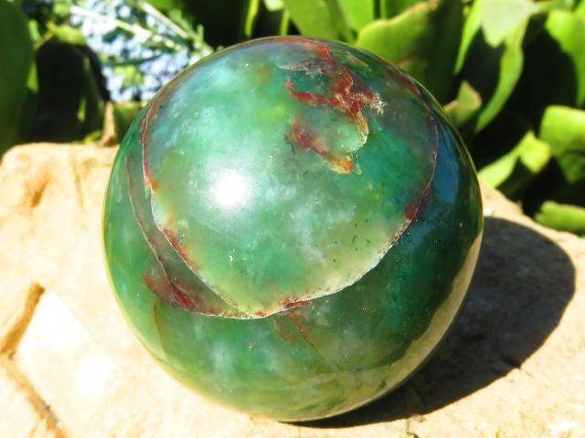 Polished Swazi Jade Ball showing brown patterns