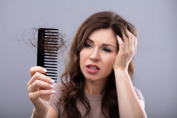20 Useful Natural Tips and Remedies to Stop Hair Fall