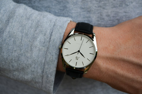 Vintage style luxury watch being worn by business owner