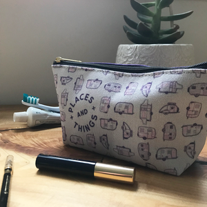 Accessory pouch or toiletries bag. Vintage trailer pattern in purple.