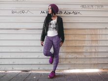 Load image into Gallery viewer, Hip young woman standing beside a grungy wall wearing leggings for women, Vintage Trailers, two-tone purple