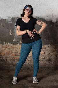 Woman wearing leggings for women with curves, Vintage Trailers, two-tone teal blue-green
