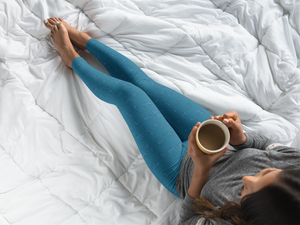 Young woman sitting in bed, drinking coffee, wearing Leggings — Vintage Trailer Grid — Two-tone Blue
