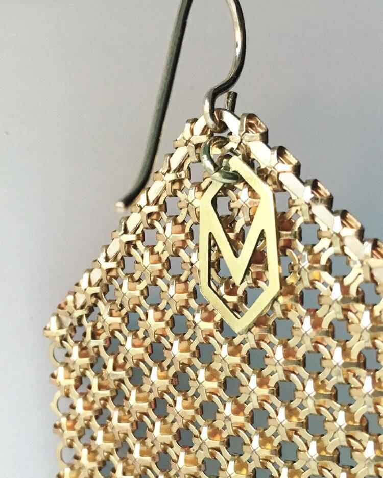 Logo signature tag on Maral Rapp recycled vintage metal mesh earrings