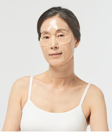 Woman wearing Oia Anti-Wrinkle patches (all in one) to get rid of wrinkles, anti aging treatment