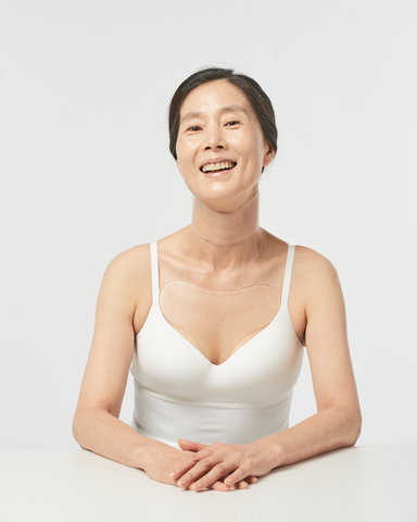 Woman wearing Oia Anti Wrinkle Patches for Neck and chest to reduce wrinkles in the decollete area