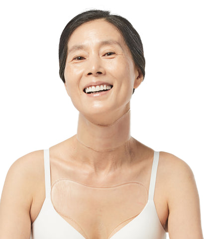 Mature woman wearing Oia Anti Wrinkle Patches for Neck and Chest to treat and prevent sleep wrinkles
