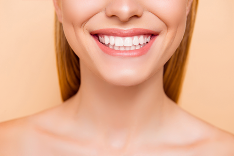 Close up of a smiling woman, Smile Lines, Nasolabial folds
