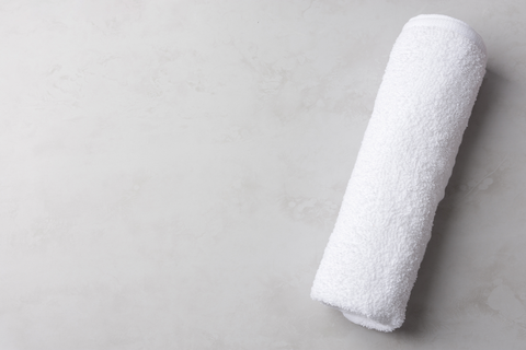 Towel roll for sleeping on back and preventing sleep wrinkles