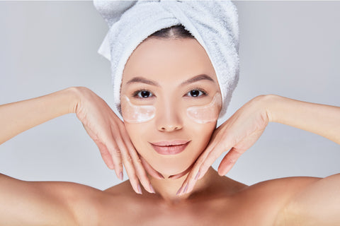 Woman wearing silicone anti wrinkle patches to get rid of under eye wrinkles
