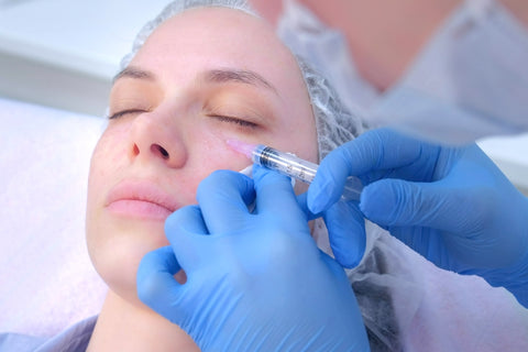 Woman getting injectable under eye treatment, filler injections