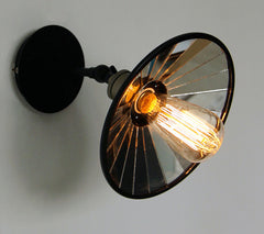 Vintage industrial look wall sconce light with black lamp shade with mirror inside.