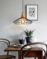 Sangkar Metal Cage Pendant Light With Wood Base model A dining room