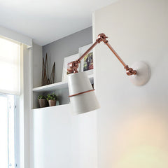 white and rose gold copper ring wall light in use